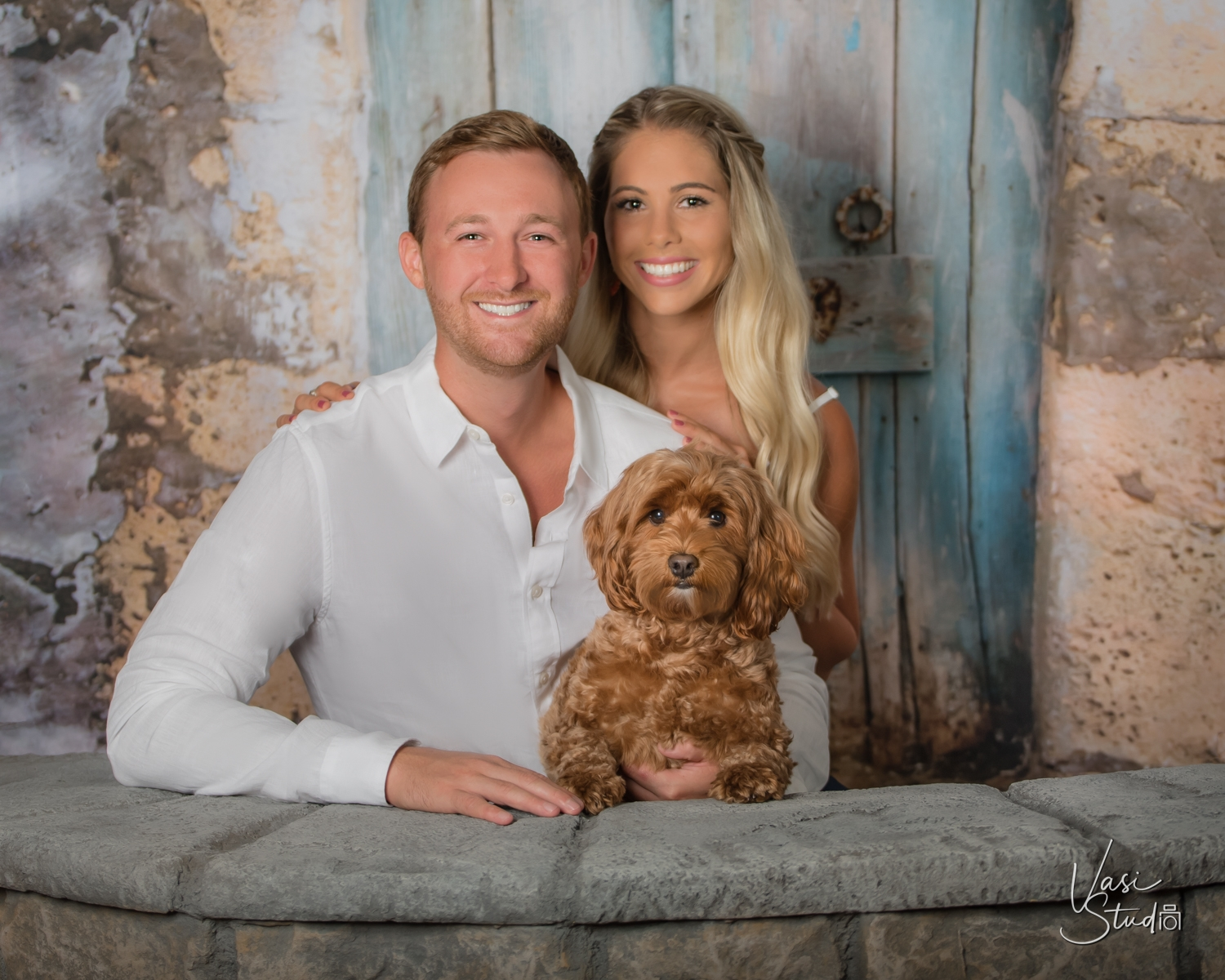 Studio session of a couple and their doggy. Call us today at 561-307-9875.